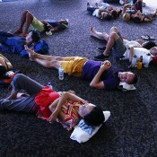 MELBOURNE, AUSTRALIA - JANUARY 16:  Tennis fans escape the heat by resting on the concourse floor of Hisense Arena during day four of the 2014 Australian Open at Melbourne Park on January 16, 2014 in Melbourne, Australia.  (Photo by Graham Denholm/Getty Images)