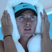 MELBOURNE, AUSTRALIA - JANUARY 16:  Maria Sharapova of Russia cools off during a break in her second round match against Karin Knapp of Italy during day four of the 2014 Australian Open at Melbourne Park on January 16, 2014 in Melbourne, Australia.  (Photo by Clive Brunskill/Getty Images)
