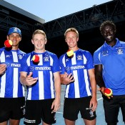 MELBOURNE, AUSTRALIA - JANUARY 16:  (L-R) North Melbourne Kangaroos AFL players Robbie Tarrant, Jack Ziebell, Liam Anthony and Majak Daw pose prior to playing tennis with a group of kids in an MLC Tennis Hot Shots session during day 4 of the 2014 Australian Open at Melbourne Park on January 16, 2014 in Melbourne, Australia.  (Photo by Graham Denholm/Getty Images)