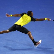 MELBOURNE, AUSTRALIA - JANUARY 18:  Gael Monfils of France plays a backhand in his third round match against Rafael Nadal of Spain during day six of the 2014 Australian Open at Melbourne Park on January 18, 2014 in Melbourne, Australia.  (Photo by Cameron Spencer/Getty Images)