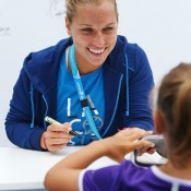 MELBOURNE, AUSTRALIA - JANUARY 18:  Dominika Cibulkova of Slovakia signs her autograph at the MLC Autograph Island during day 6 of the 2014 Australian Open at Melbourne Park on January 18, 2014 in Melbourne, Australia.  (Photo by Graham Denholm/Getty Images)