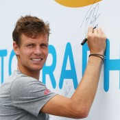 MELBOURNE, AUSTRALIA - JANUARY 18:  Tomas Berdych of the Czech Republic signs his autograph at the MLC Autograph Island during day 6 of the 2014 Australian Open at Melbourne Park on January 18, 2014 in Melbourne, Australia.  (Photo by Graham Denholm/Getty Images)