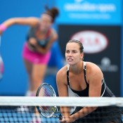 MELBOURNE, AUSTRALIA - JANUARY 18:  Jarmila Gajdosova of Australia and Ajla Tomljanovic of Croatia in action in their second round doubles match against Annika Beck of Germany and Andrea Petkovic of Germany during day six of the 2014 Australian Open at Melbourne Park on January 18, 2014 in Melbourne, Australia.  (Photo by Chris Hyde/Getty Images)