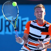Samuel Groth of Australia plays a forehand in his first round match against Vasek Pospisil of Canada during day one of the 2014 Australian Open at Melbourne Park on January 13, 2014 in Melbourne, Australia.  (Photo by Quinn Rooney/Getty Images)