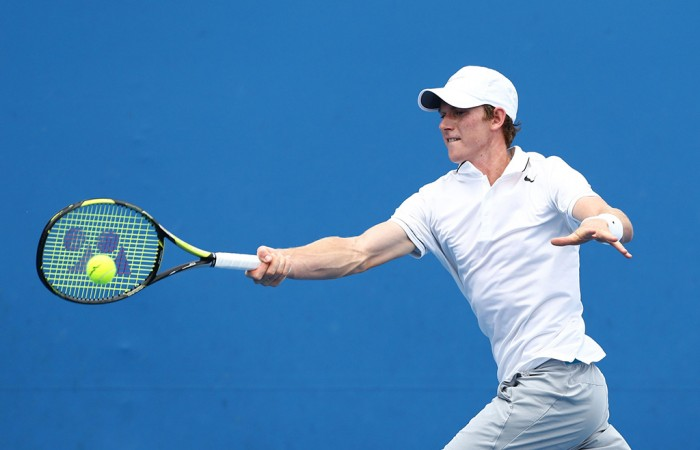 Harry Bourchier of Australia plays a forehand in his first round junior boys' match against Sumit Nagal of India during the 2014 Australian Open Junior Championships at Melbourne Park on January 18, 2014 in Melbourne, Australia.  (Photo by Matt King/Getty Images)