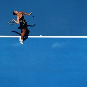 Jarmila Gajdosova of Australia serves in her first round match against Angelique Kerber of Germany during day one of the 2014 Australian Open at Melbourne Park on January 13, 2014 in Melbourne, Australia.  (Photo by Matt King/Getty Images)