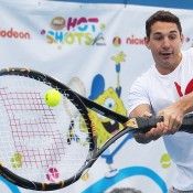 NRL player Billy Slater hits a backhand during the Celebrity Slam match as part of Kids Tennis Day ahead of the 2014 Australian Open at Melbourne Park on January 11, 2014 in Melbourne, Australia.  (Photo by Graham Denholm/Getty Images)