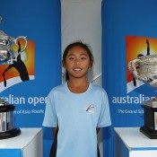 A young girl poses with the Championship trophies during Kids Tennis Day ahead of the 2014 Australian Open at Melbourne Park on January 11, 2014 in Melbourne, Australia.  (Photo by Graham Denholm/Getty Images)