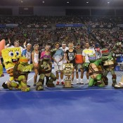 Lleyton Hewitt, Eugenie Bouchard, Samantha Stosur, Roger Federer, Victoria Azarenka, Rafael Nadal, Pat Rafter and Nickelodeon characters and presenters pose following the Rod Laver Arena Spectacular as part of Kids Tennis Day ahead of the 2014 Australian Open at Melbourne Park on January 11, 2014 in Melbourne, Australia.  (Photo by Graham Denholm/Getty Images)