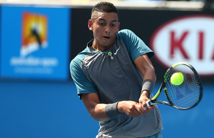 MELBOURNE, AUSTRALIA - JANUARY 14:  Nick Kyrgios of Australia plays a backhand in his first round match against Benjamin Becker of Germany during day two of the 2014 Australian Open at Melbourne Park on January 14, 2014 in Melbourne, Australia.  (Photo by Robert Prezioso/Getty Images)