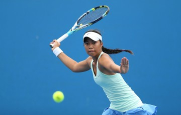 MELBOURNE, AUSTRALIA - JANUARY 18:  Lizette Cabrera of Australia plays a forehand in her first round junior girls' match against Freya Christie of Great Britain during the 2014 Australian Open Junior Championships at Melbourne Park on January 18, 2014 in Melbourne, Australia.  (Photo by Clive Brunskill/Getty Images)