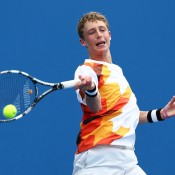 Marc Polmans of Australia plays a forehand in his first round junior boys' match against Pedro Martinez Portero of Spain during the 2014 Australian Open Junior Championships at Melbourne Park on January 18, 2014 in Melbourne, Australia.  (Photo by Matt King/Getty Images)
