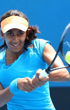 MELBOURNE, AUSTRALIA - JANUARY 19:  Naiktha Bains of Australia plays a backhand in her first round junior girls' match against Shiori Fukuda of Japan during the 2014 Australian Open Junior Championships at Melbourne Park on January 19, 2014 in Melbourne, Australia.  (Photo by Robert Prezioso/Getty Images)