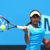 Naiktha Bains of Australia celebrates a point in her first round junior girls' match against Shiori Fukuda of Japan during the 2014 Australian Open Junior Championships at Melbourne Park on January 19, 2014 in Melbourne, Australia.  (Photo by Robert Prezioso/Getty Images)