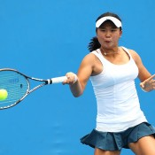 MELBOURNE, AUSTRALIA - JANUARY 19: Olivia Tjandramulia of Australia plays a forehand in her first round junior girls' match against Nozomi Ohya of Japan during the 2014 Australian Open Junior Championships at Melbourne Park on January 19, 2014 in Melbourne, Australia.  (Photo by Robert Prezioso/Getty Images)