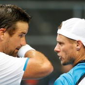 MELBOURNE, AUSTRALIA - JANUARY 15:  Pat Rafter of Australia and Lleyton Hewitt of Australia talk between points in their first round men's doubles match against Eric Butorac of the United States and Raven Klassen of South Africa during day three of the 2014 Australian Open at Melbourne Park on January 15, 2014 in Melbourne, Australia.  (Photo by Scott Barbour/Getty Images)