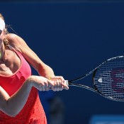 Olivia Rogowska of Australia plays a backhand in her second round match against Elina Svitolina of the Ukraine during day four of the 2014 Australian Open at Melbourne Park on January 16, 2014 in Melbourne, Australia.  (Photo by Michael Dodge/Getty Images)