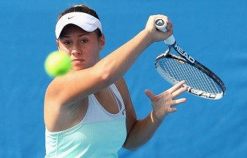 MELBOURNE, AUSTRALIA - JANUARY 09:  Sara Tomic of Australia plays a forehand in her match against Tamira Paszek of Austria during qualifying for the 2014 Australian Open at Melbourne Park on January 9, 2014 in Melbourne, Australia.  (Photo by Robert Prezioso/Getty Images)