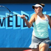 Sara Tomic of Australia plays a forehand in her match against Tamira Paszek of Austria during qualifying for the 2014 Australian Open at Melbourne Park on January 9, 2014 in Melbourne, Australia.  (Photo by Robert Prezioso/Getty Images)