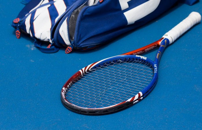 Tennis racquet and bag. GEORGINA LEEDER