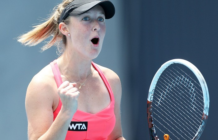 Storm Sanders of Australia celebrates winning match point in her first round match against Shuai Peng of China during day three of the Moorilla Hobart International at Domain Tennis Centre on January 7, 2014 in Hobart, Australia.  (Photo by Mark Metcalfe/Getty Images)