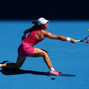 Samantha Stosur of Australia plays a backhand in her first round match against Klara Zakopalova of the Czech Republic during day one of the 2014 Australian Open at Melbourne Park on January 13, 2014 in Melbourne, Australia.  (Photo by Cameron Spencer/Getty Images)