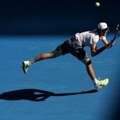 Jordan Thompson of Australia plays a backhand in his first round match against Jerzy Janowicz of Poland during day one of the 2014 Australian Open at Melbourne Park on January 13, 2014 in Melbourne, Australia.  (Photo by Michael Dodge/Getty Images)
