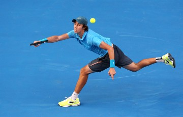 Jordan Thompson of Australia plays a forehand in his first round match against Jerzy Janowicz of Poland during day one of the 2014 Australian Open at Melbourne Park on January 13, 2014 in Melbourne, Australia.  (Photo by Michael Dodge/Getty Images)