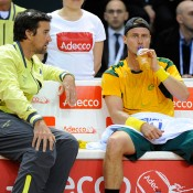 Pat Rafter speaks to Lleyton Hewitt during a change of ends, France, 2014.  © FFT/P. Montigny
