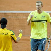 Lleyton Hewitt and Chris Guccione celebrate after winning a point, February, 2014.. © FFT/P. Montigny