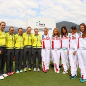 HOBART, AUSTRALIA - FEBRUARY 07:  Australian and Russian team members pose for a photo during the official draw ahead of the Fed Cup Tie between Australia and Russia on February 7, 2014 in Hobart, Australia.  (Photo by Mark Nolan/Getty Images)