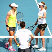 Samantha Stosur (L) and Alicia Molik of Australia chat during a practice session ahead of the Fed Cup Tie between Australia and Russia at the Domain Tennis Centre on February 7, 2014 in Hobart, Australia.  (Photo by Mark Nolan/Getty Images)