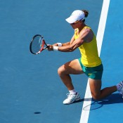 Samantha Stosur of Australia plays a backhand in her singles match against Veronica Kudermetova of Russia during the Fed Cup tie between Australia and Russia on February 8, 2014 in Hobart, Australia.  (Photo by Mark Nolan/Getty Images)