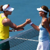 Samantha Stosur (L) of Australia and Veronica Kudermetova of Russia shake hands after Stosur's win during the Fed Cup tie between Australia and Russia on February 8, 2014 in Hobart, Australia.  (Photo by Mark Nolan/Getty Images)