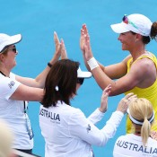 Samantha Stosur of Australia celebrates with the Australian bench after winning her singles match against Victoria Kan of Russia during the Fed Cup tie between Australia and Russia at the Domain Tennis Centre on February 9, 2014 in Hobart, Australia.  (Photo by Mark Nolan/Getty Images)