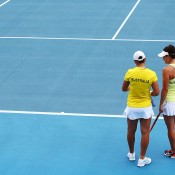 Ashleigh Barty (L) and Casey Dellacqua of Australia talk tactics in their doubles match against Irina Khromacheva Valeria Solovyeva of Russia during the Fed Cup tie between Australia and Russia at the Domain Tennis Centre on February 9, 2014 in Hobart, Australia.  (Photo by Mark Nolan/Getty Images)