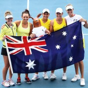 HOBART, AUSTRALIA - FEBRUARY 09: Storm Sanders, Casey Dellacqua, Ashleigh Barty, Samantha Stosur and Alicia Molik of Australia after the Fed Cup tie between Australia and Russia at the Domain Tennis Centre on February 9, 2014 in Hobart, Australia.  (Photo by Mark Nolan/Getty Images)