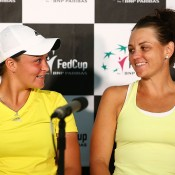 Ashleigh Barty (L) and Casey Dellacqua of Australia talk to the media after the Fed Cup tie between Australia and Russia at the Domain Tennis Centre on February 9, 2014 in Hobart, Australia.  (Photo by Mark Nolan/Getty Images)