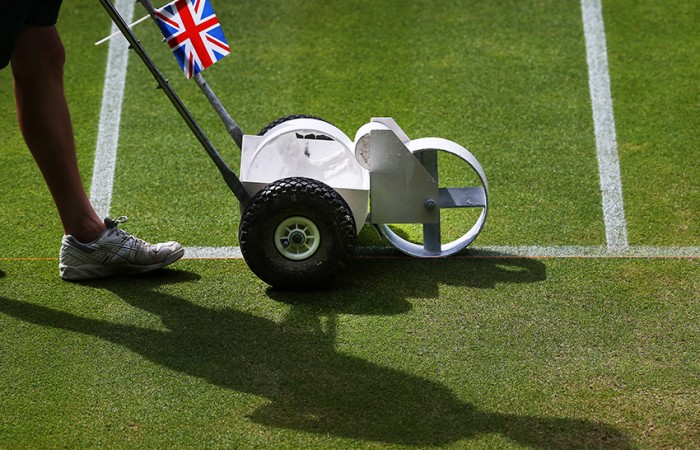 A groundsman paints the white lines on the grass of Centre Court at the Wimbledon Lawn Tennis Championships on July 1, 2013 in London, England; Peter Macdiarmid/Getty Images