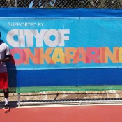 Top seed Jarmere Jenkins of the US poses with his trophy after defeating Australian Luke Saville in the singles final at the City of Onkaparinga Tennis International; Tennis Australia