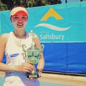 Su Jeong Jang of Korea poses with her trophy after winning the City of Salisbury Tennis International singles final over Yafan Wang of China 6-3 7-6(6); Tennis Australia