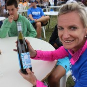 Tennis Australia community manager Karen Clydesdale samples local wine and special AO Blitz labels provided for fund-raising; Tennis Australia