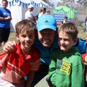 Australian Grand Slam doubles champion Todd Woodbridge meets young tennis enthusiasts Jack (left) and Ben Weckert (right) at a MLC Tennis Hot Shots clinic given at the Watervale AO Blitz town party; Tennis Australia