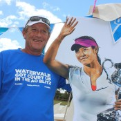 Watervale Tennis Club president David Long poses with a picture of AO2014 champion Li Na at the AO Blitz town party in Watervale, South Australia; Tennis Australia