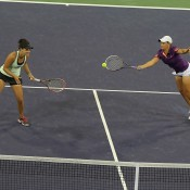 Casey Dellacqua (L) and Ash Barty in action during their first round doubles victory at the BNP Paribas Open at Indian Wells; Michael Cummo/BNP Paribas Open