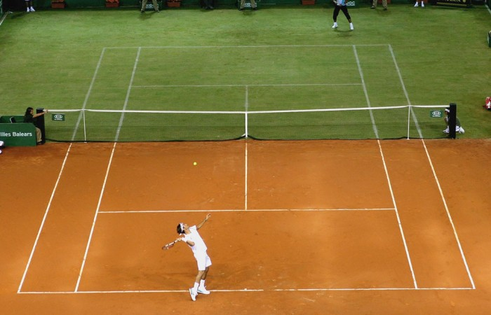 Roger Federer and Rafael Nadal play on a half clay, half grass court. GETTY IMAGES