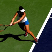 Casey Dellacqua of Australia returns a shot to Simona Halep of Romania during the BNP Parabas Open at the Indian Wells Tennis Garden on March 12, 2014 in Indian Wells, California.  (Photo by Matthew Stockman/Getty Images)