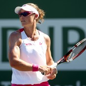 Samantha Stosur of Australia returns a shot to Ana Ivanovic of Serbia during the BNP Parabas Open at the Indian Wells Tennis Garden on March 10, 2014 in Indian Wells, California.  (Photo by Matthew Stockman/Getty Images)