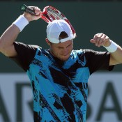 Lleyton Hewitt of Australia reacts after losing a point to Kevin Anderson of the Republic of South Africa during the BNP Paribas Open at Indian Wells Tennis Garden on March 8, 2014 in Indian Wells, California.  (Photo by Jeff Gross/Getty Images)