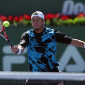 Lleyton Hewitt of Australia returns a forehand volley to Kevin Anderson of the Republic of South Africa during the BNP Paribas Open at Indian Wells Tennis Garden on March 8, 2014 in Indian Wells, California.  (Photo by Jeff Gross/Getty Images)